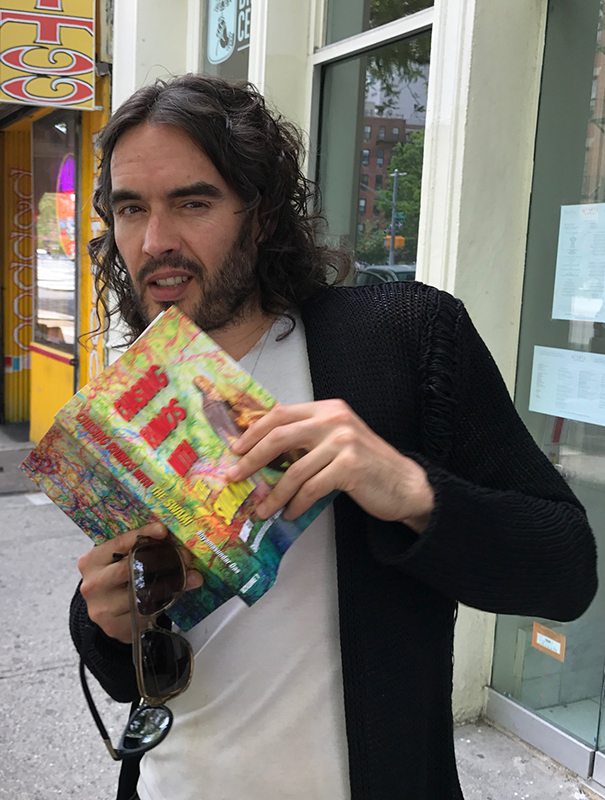 Russell Brand with chasing rhinos book
